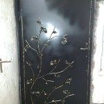 Кованое украшение двери