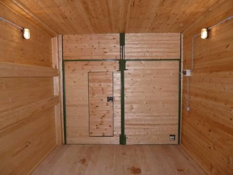 Чем утеплить двери в гараже: обшивка из вагонки