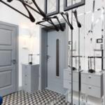 Оригинальное решение – серые крашеные двери на фоне белоснежных стен