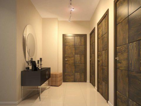 Сочетание входной двери с остальными позволяет объединить интерьер прихожей в единое целое